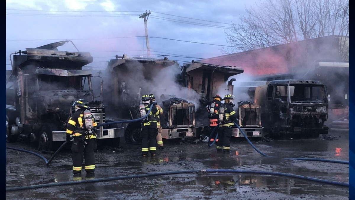Andover firefighters extinguish 5 trucks engulfed in flames