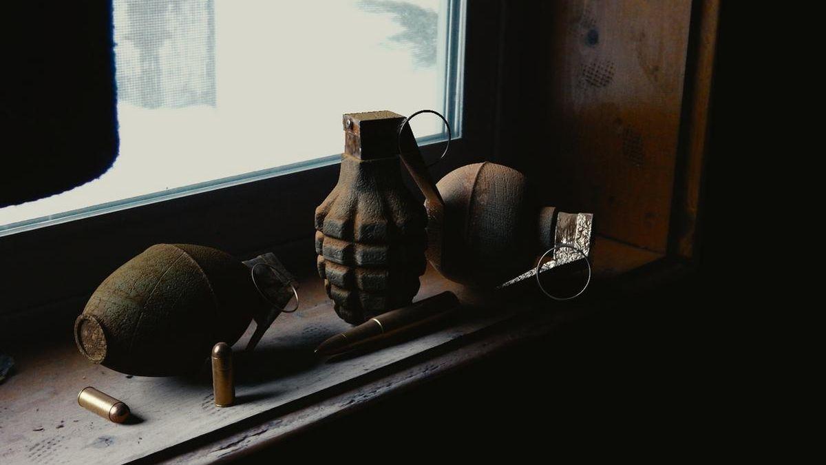 Boys magnet fishing reel in old grenade