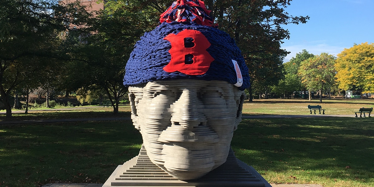 Boston Fiedler sculpture adorned with giant Red Sox hat