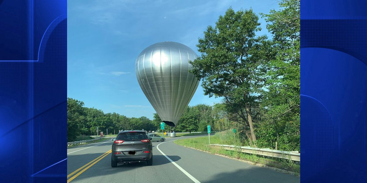 Basket case: Hot air balloon blown off course, lands on Andover highway