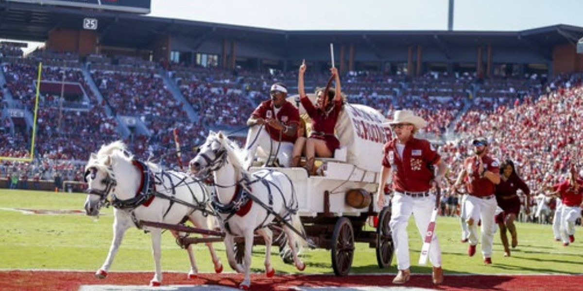 Scary moment: Oklahoma's 'Sooner Schooner' tips over after touchdown