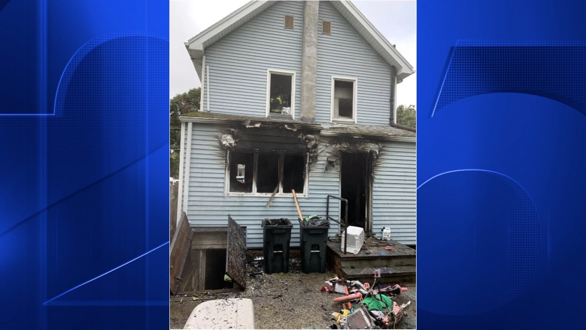 Officers catch woman as she leaps out of burning Stoneham home