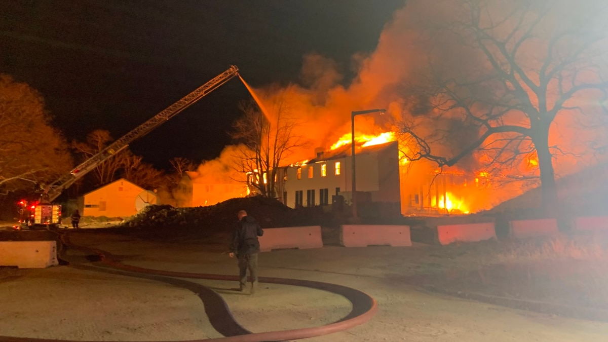 Firefighters battle 2-alarm fire at abandoned naval air station in Weymouth