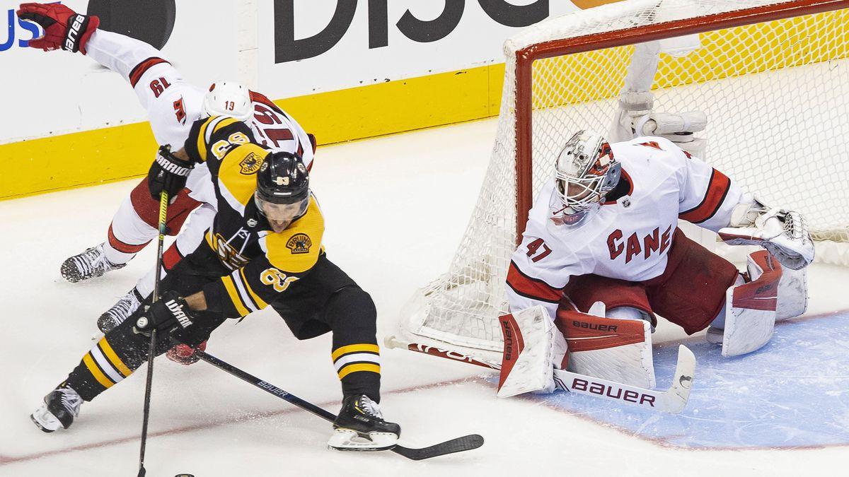 Hamilton helps Carolina beat Boston 3-2, tie series 1-1