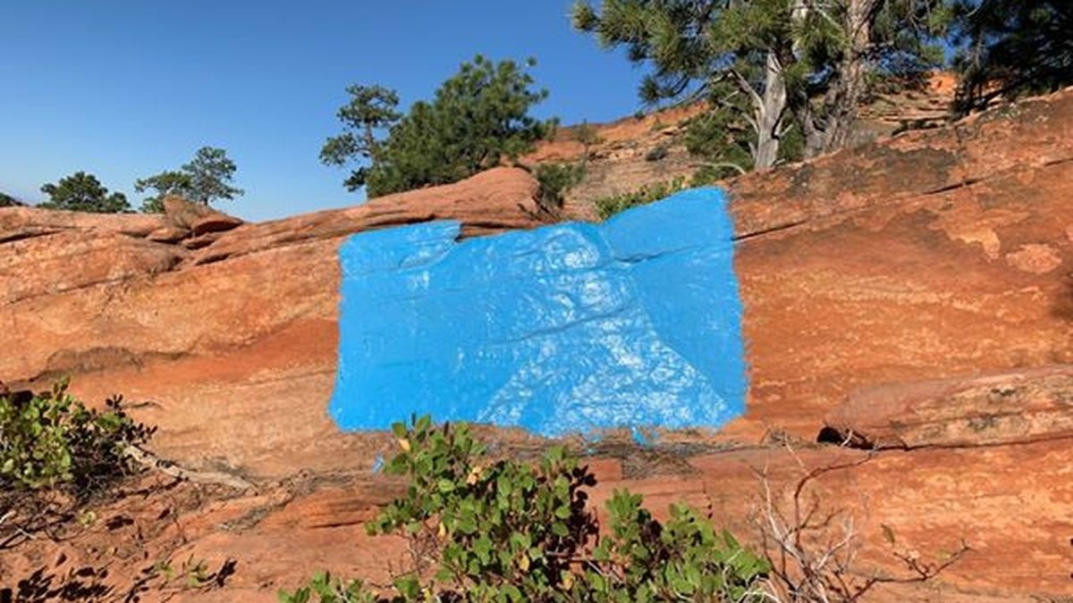 Park rangers searching for vandals who painted rock formations blue